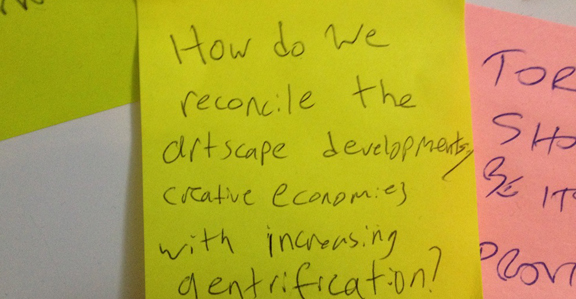 A post-it with one of the debate topics suggested by the community at the  interactive debate installation at The Next Stage Festival